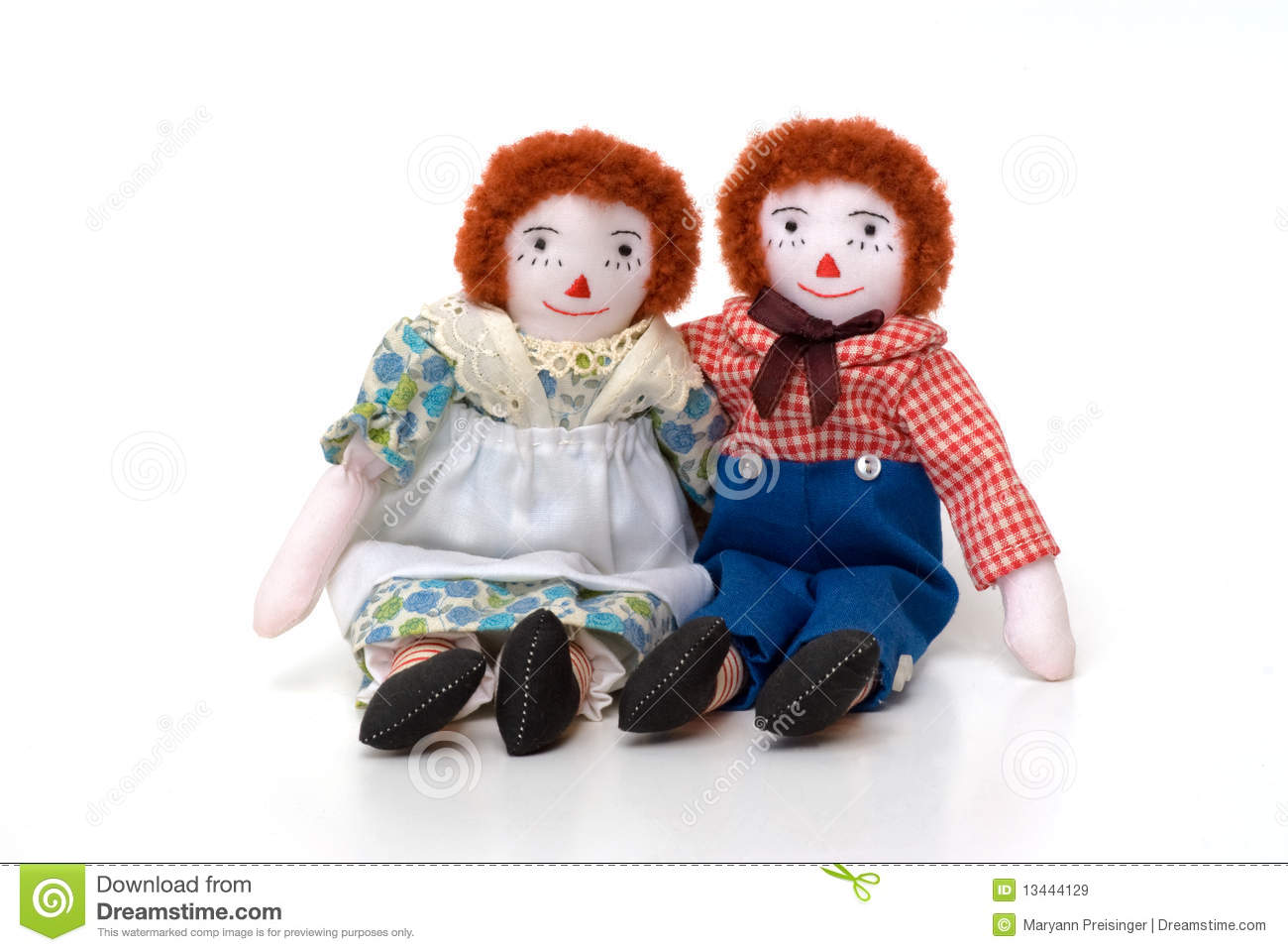 raggedy ann and andy cloth dolls sitting together royalty free