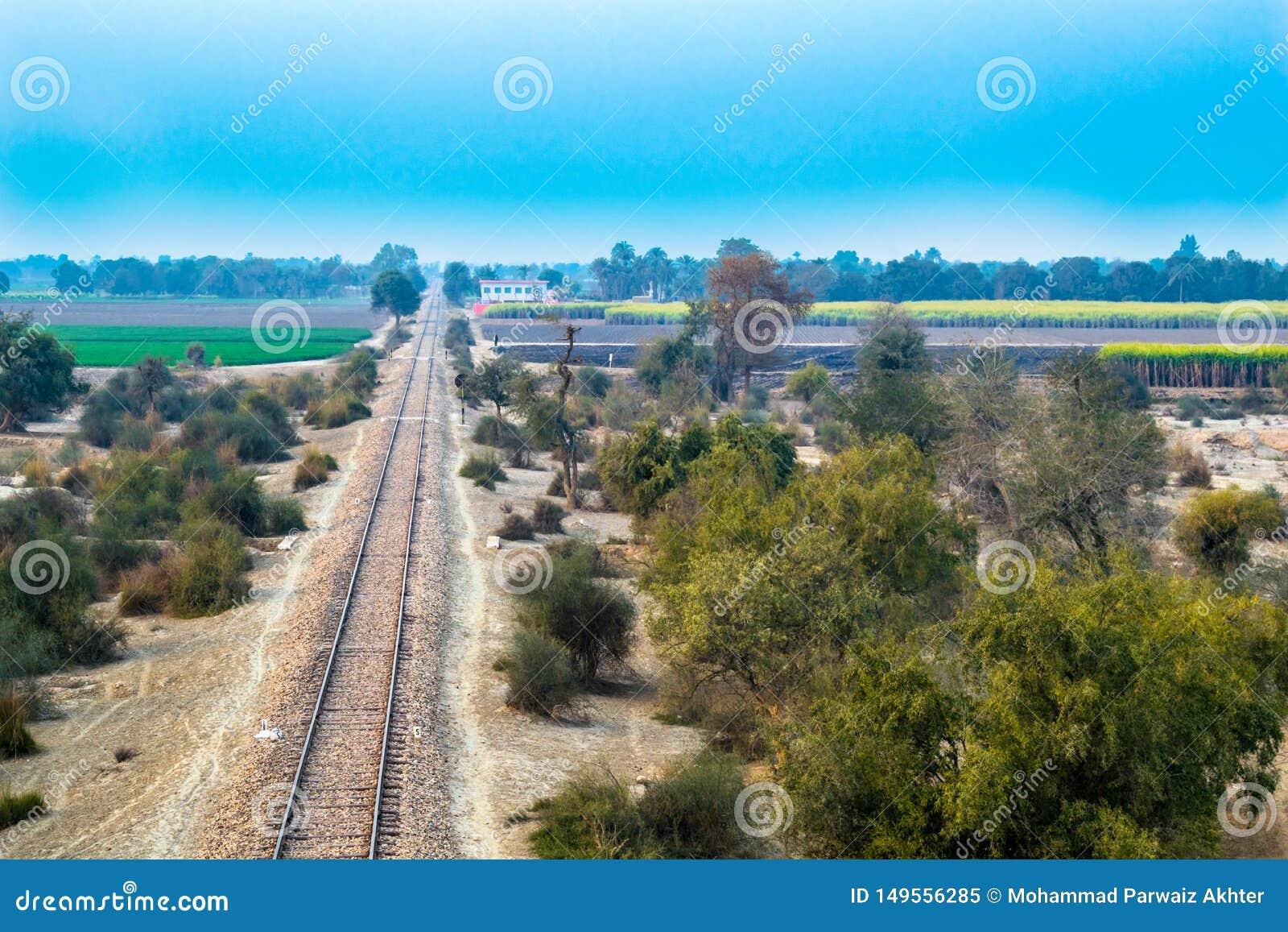 Railroad railway line in pakistan countryside