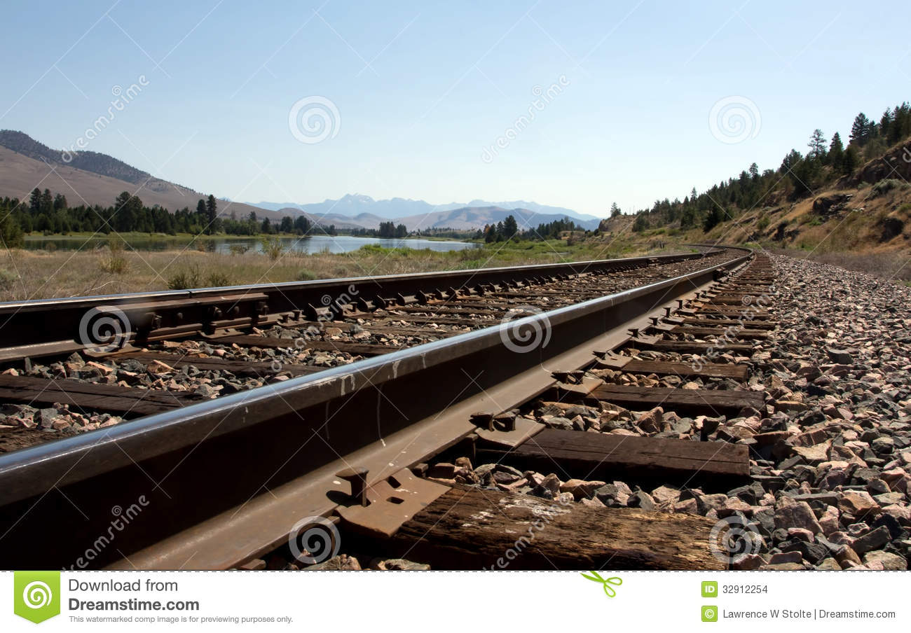 Railroad Tracks Along The River Stock Images - Image: 32912254