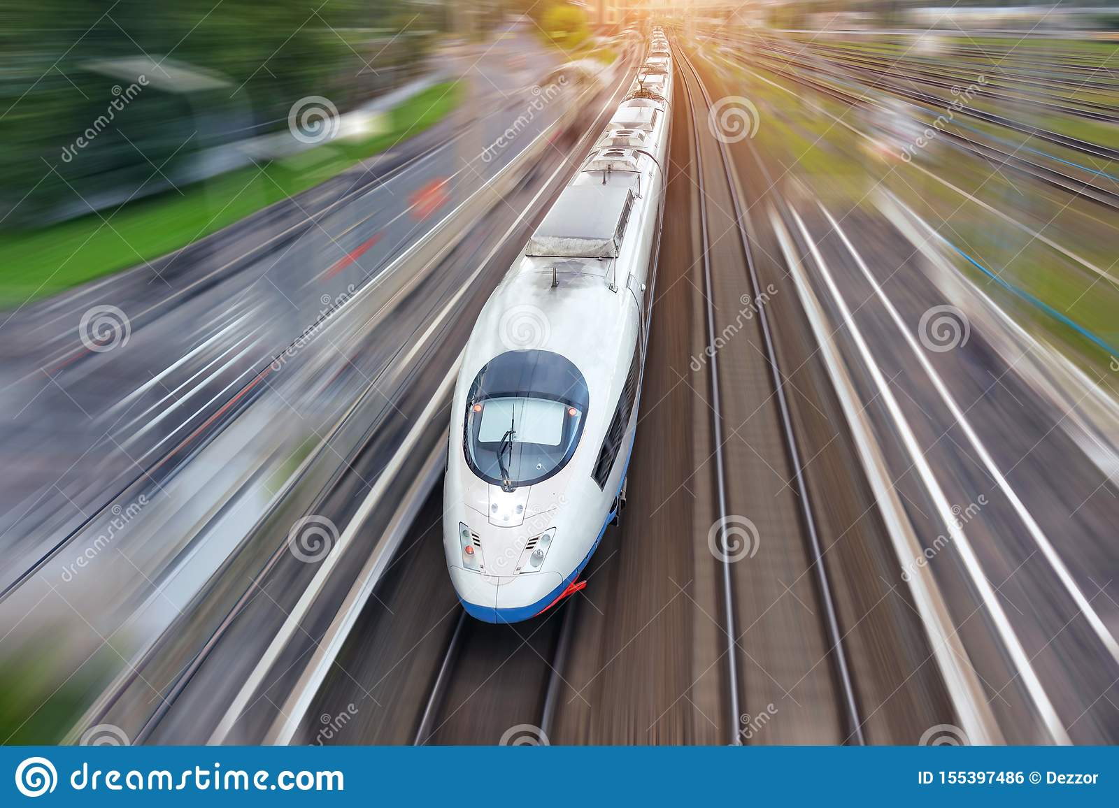 Railroad travel high speed fast train passenger locomotive motion blur effect in the city, top aerial view from above