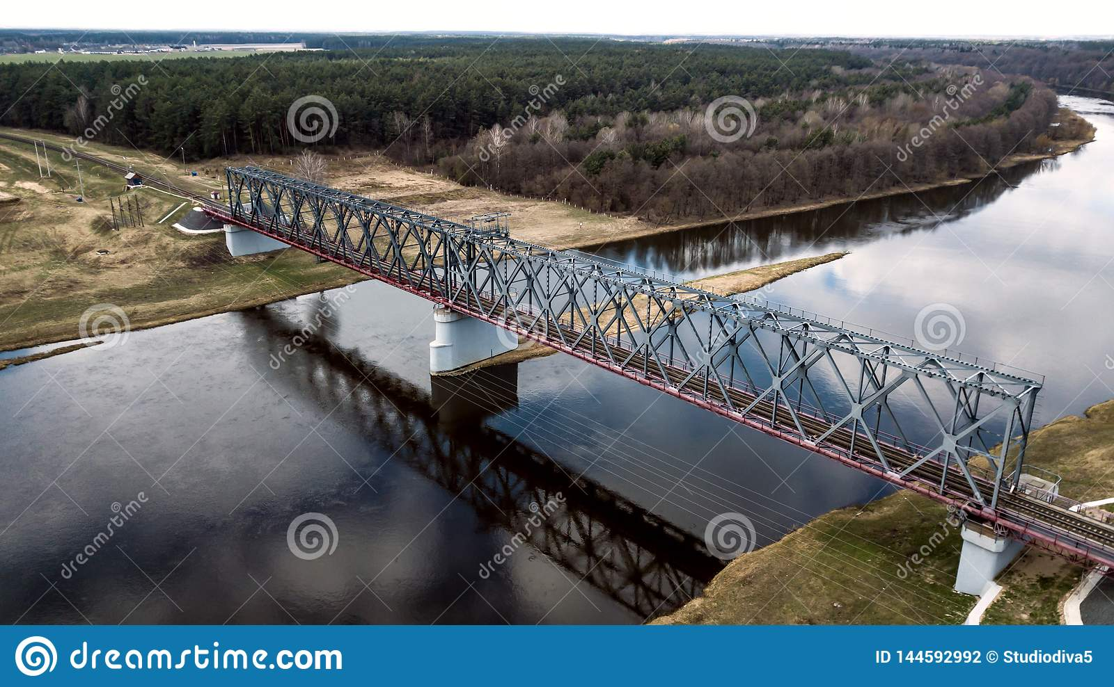 Railway bridge over the river aerial photography with a drone