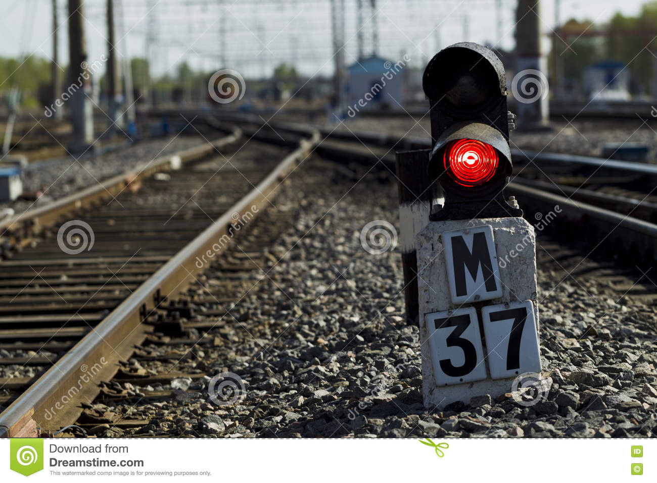 Railway Semaphore Against The Background Tracks And