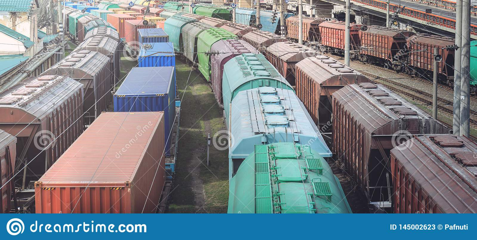 Railway wagons with cargo of metal and grain in port of Odessa. trains are waiting in line for loading at cargo terminal.