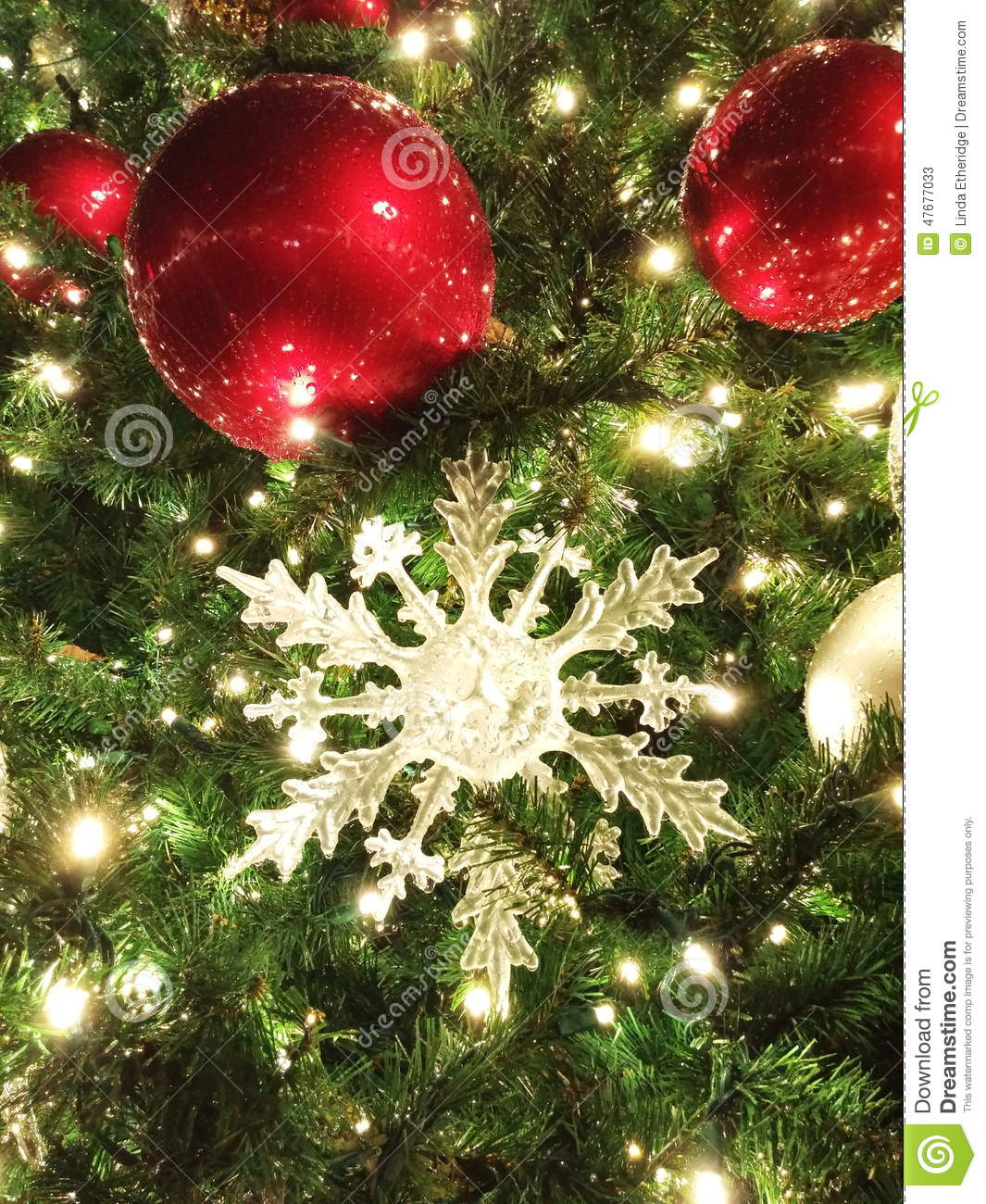 oversized christmas ball and star ornaments beaded with rain closeup vertical portrait