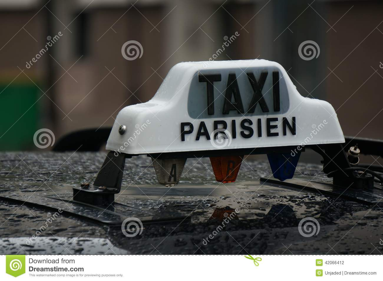 rain on a black paris taxi with a white taxi parisien sign on top stock photo image 42066412. Black Bedroom Furniture Sets. Home Design Ideas