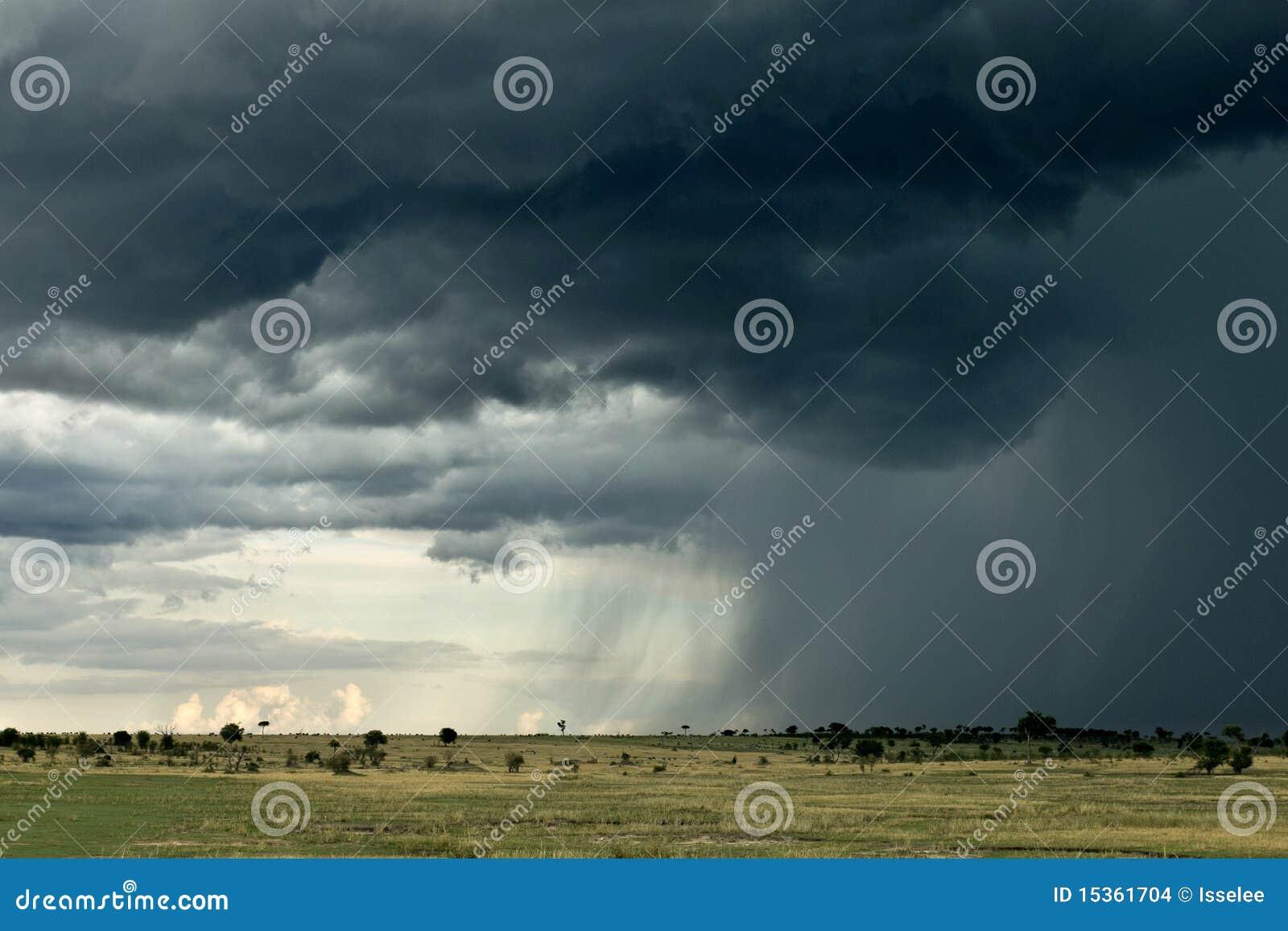 Rain cloud over Africa landscape