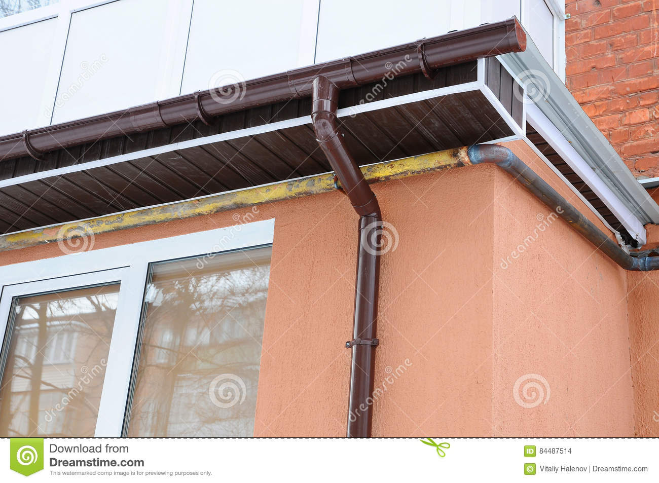 Rain Gutter On The Roof Of The Balcony New Gutters For