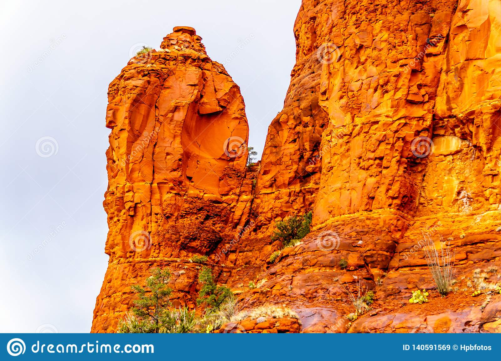 Rain pouring down on the geological formations of the red sandstone buttes surrounding the Chapel of the Holy Cross at Sedona