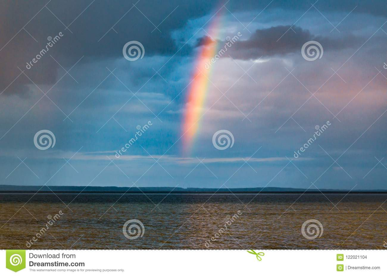 Rain and rainbow over the water