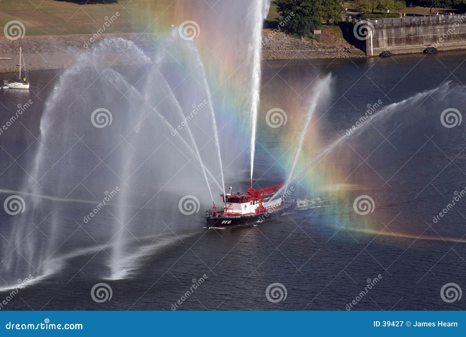 Rainbow across fire boat in Portland, Oregon.