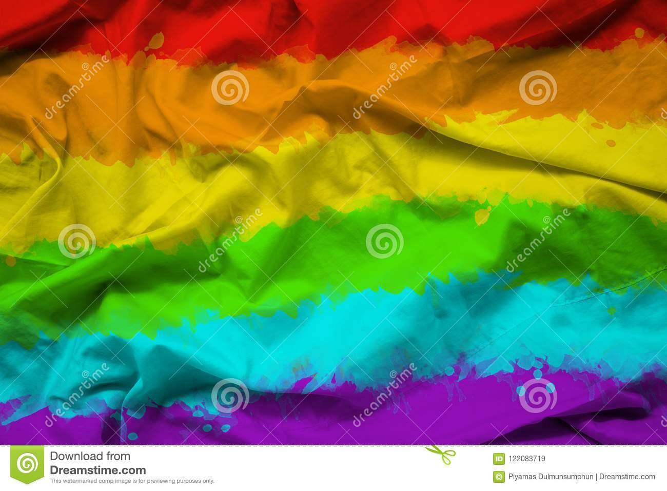 Rainbow flag of LGBTQ for Pride month on fabric texture with ripple