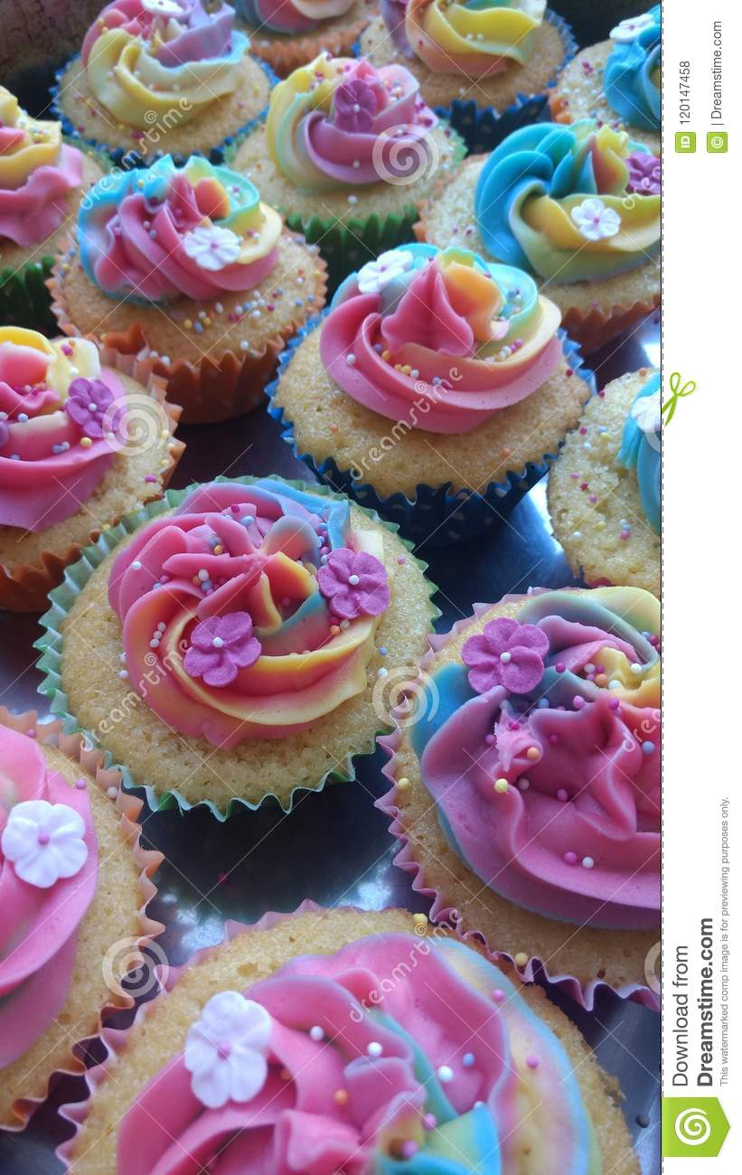 Beautiful Cupcakes Decorated With Rainbow Buttercream Icing