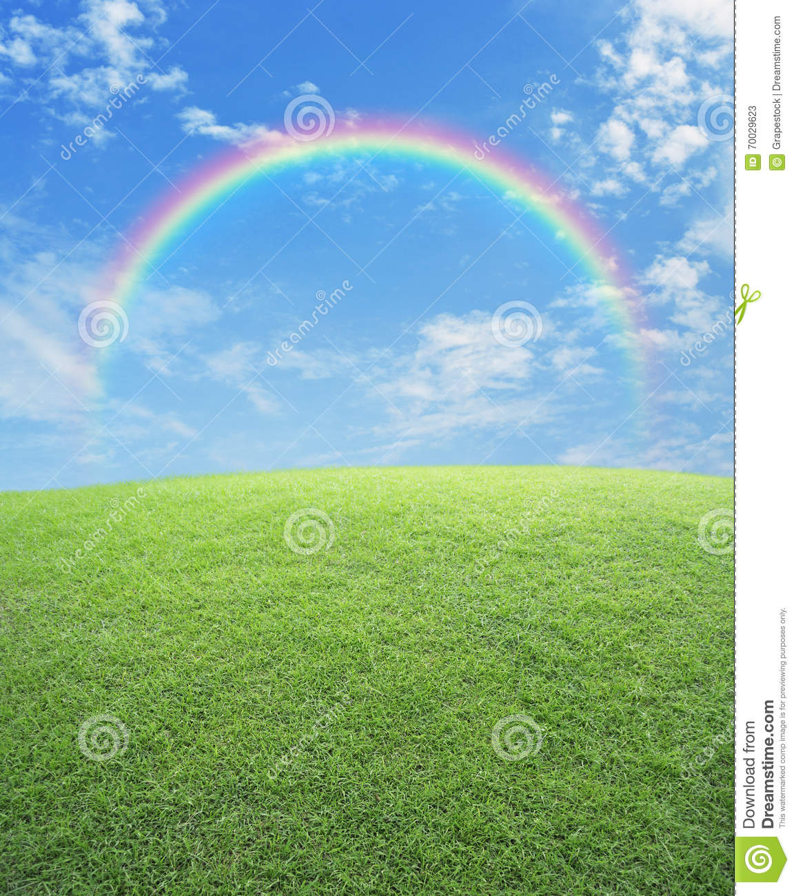 rainbow with green grass field over blue sky stock image - image of