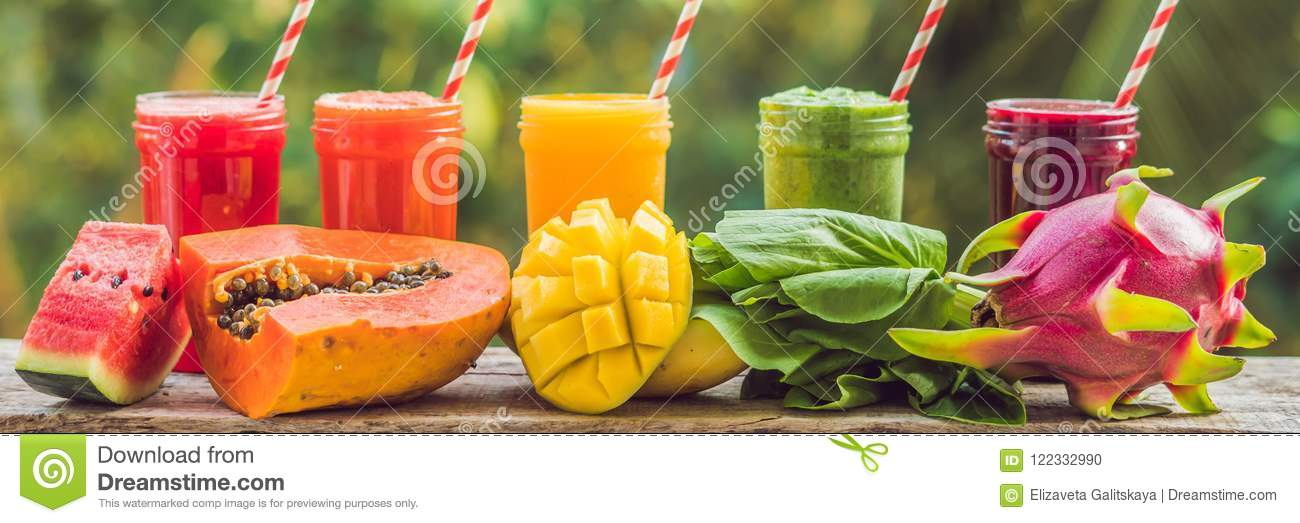 Rainbow from smoothies. Watermelon, papaya, mango, spinach and dragon fruit. Smoothies, juices, beverages, drinks variety with fre