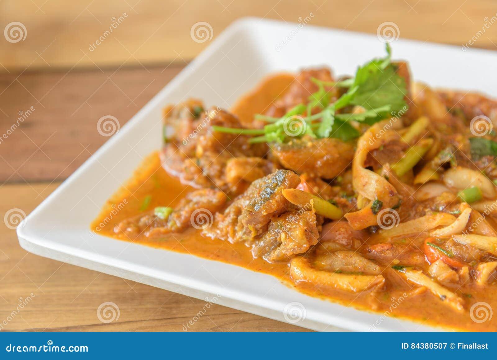 Rainbow trout stir fried with tom yam dressing