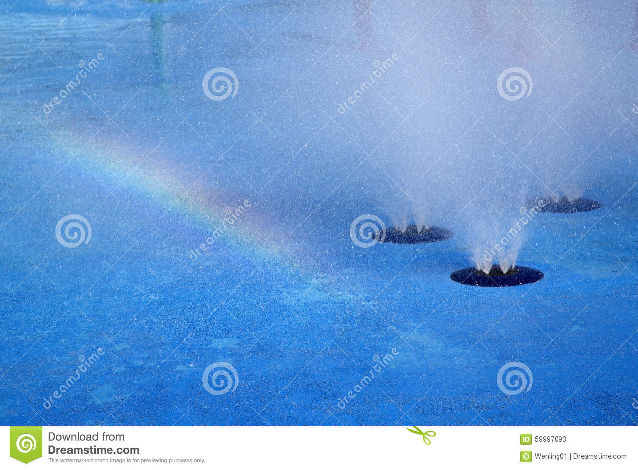 Rainbow and water fountain background