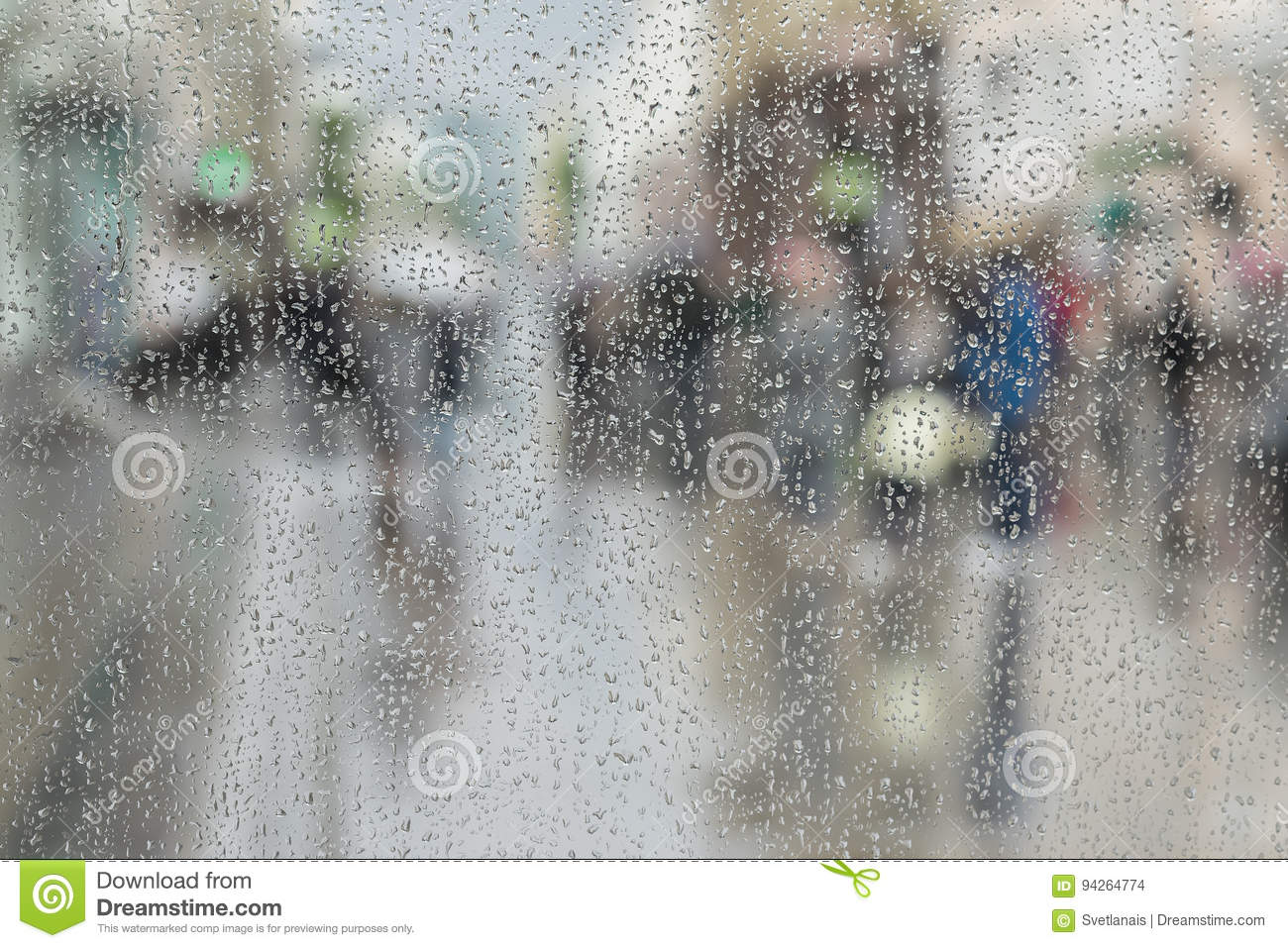 Raindrops on window glass, people walk on road in rainy day, blurred motion abstract background. Concept of shopping