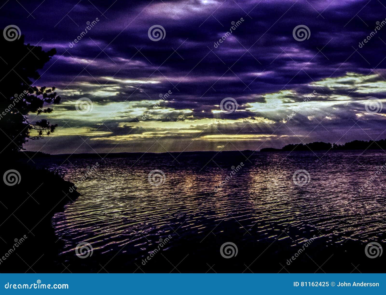 Rainy lake at sunset