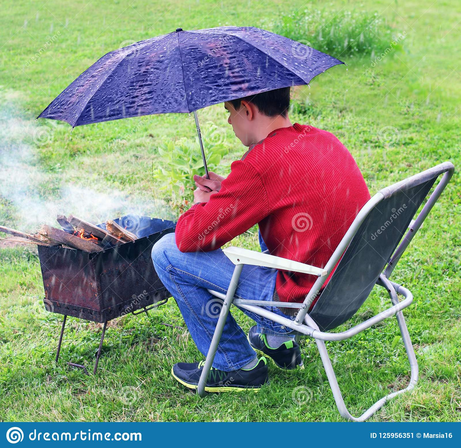 Rainy situation. Protection brazier from rain.