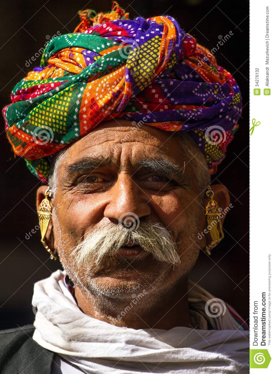 A rajasthani man wearing traditiona colorful turban for Traditional photos