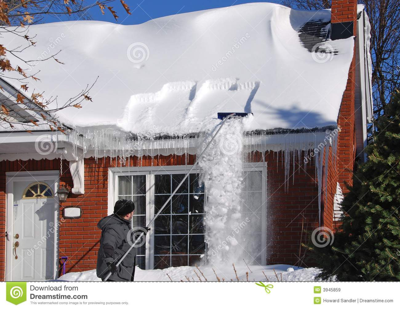 Raking Snow Off The Roof Royalty Free Stock Images Image