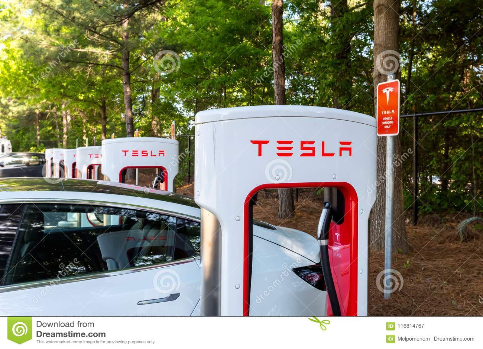 Charging A Tesla Model 3 At A Tesla Supercharger Station In