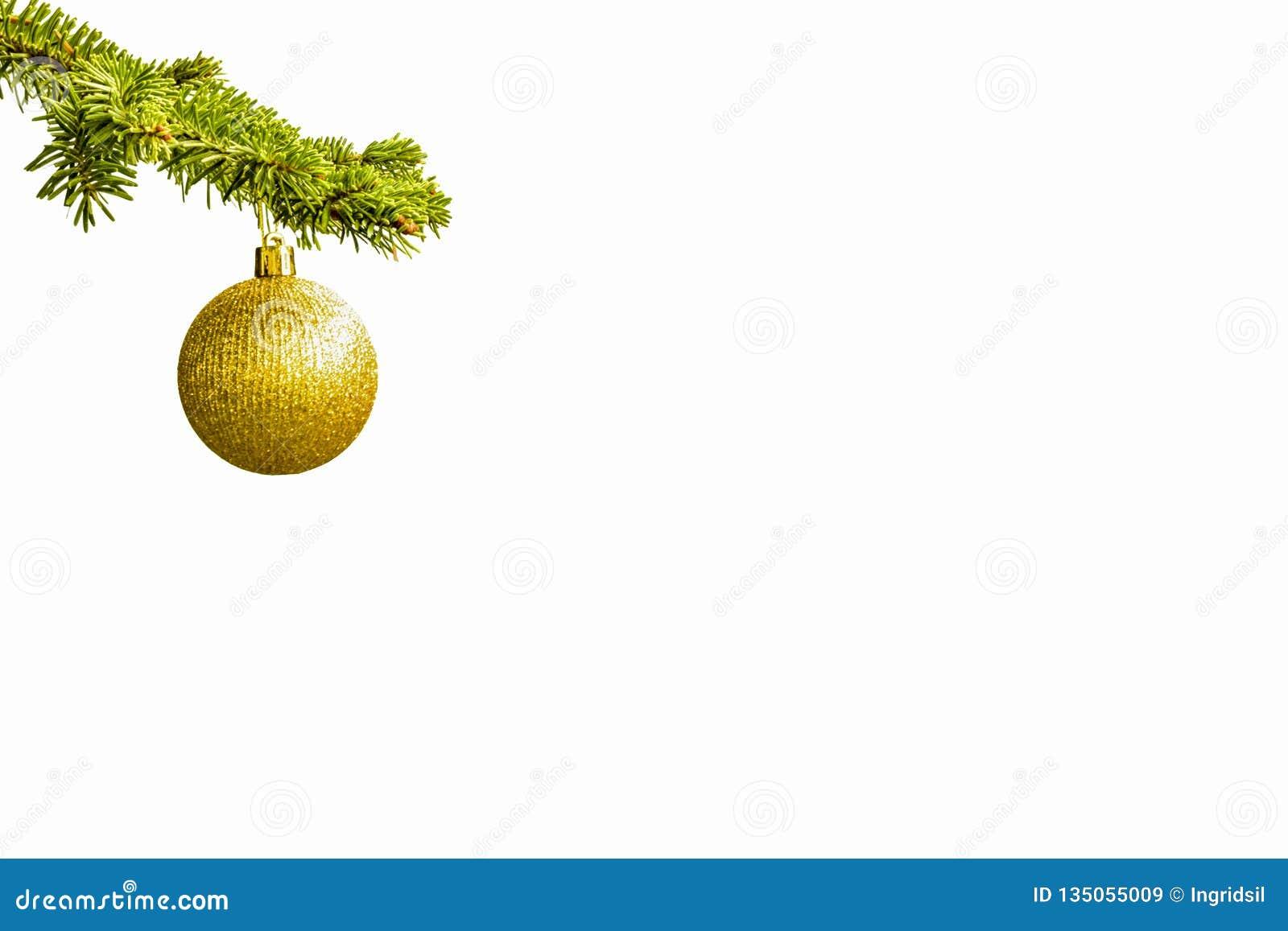 Rama de árbol de abeto con una bola de oro del brillo en el fondo blanco Efectos de Bokeh christmastime Postal de la Navidad