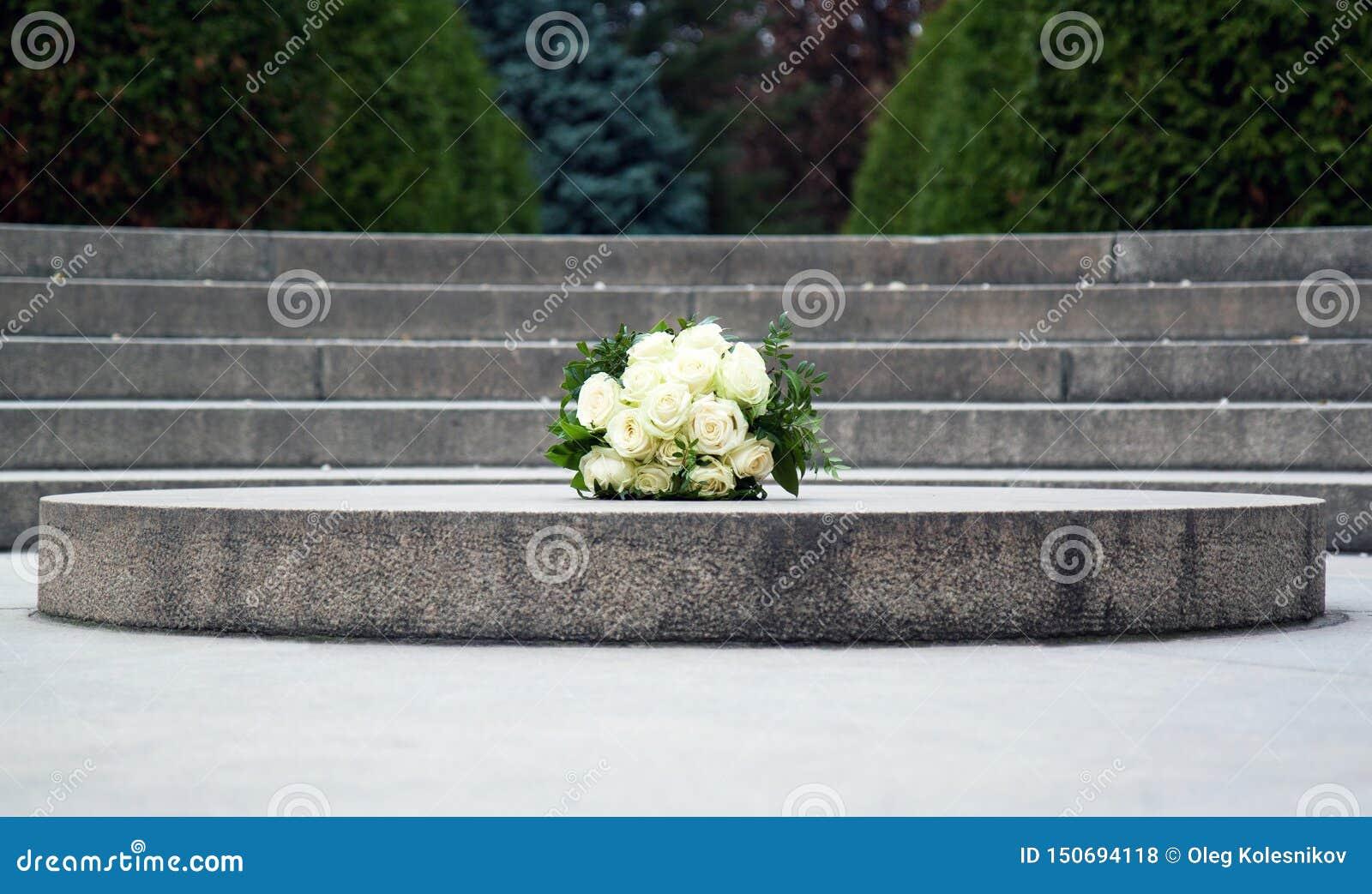 Ramalhete do casamento das rosas no granito