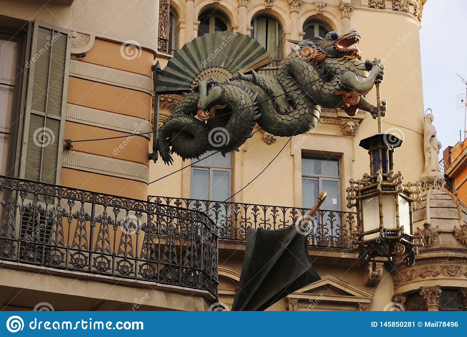 Sculpture of the dragon to decorate the facade of a building in Barcelona