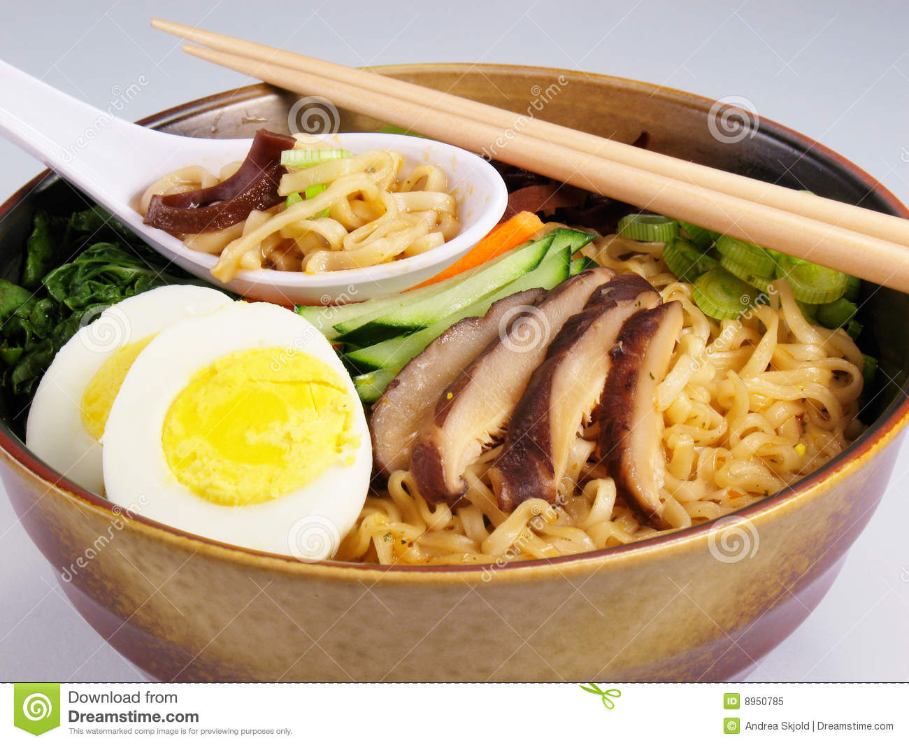 Ramen soup with hard boiled egg, vegetables, and mushrooms.