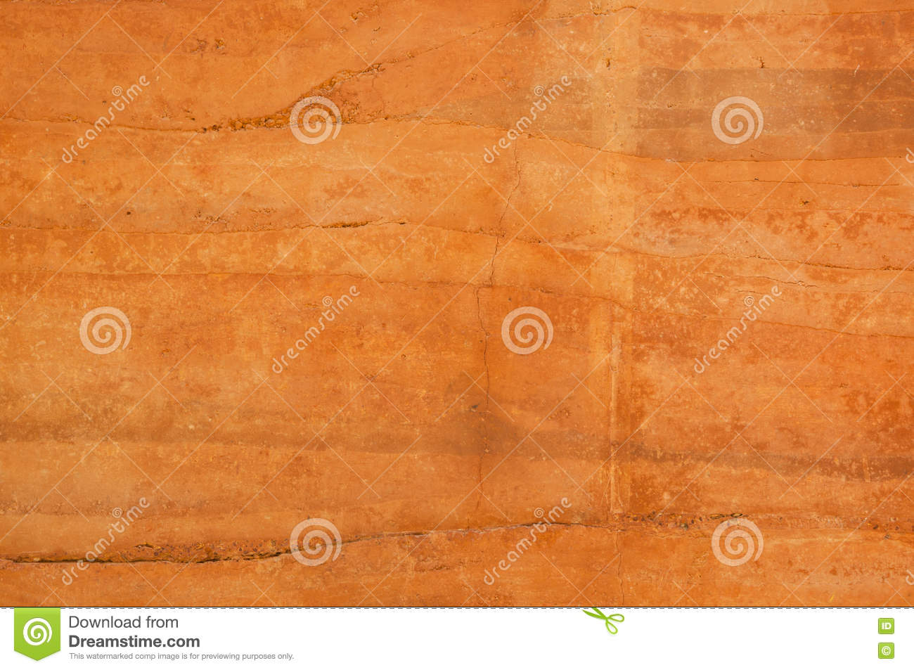 Different Shades Of Orange rammed earth wall with different shades of orange soil stock photo