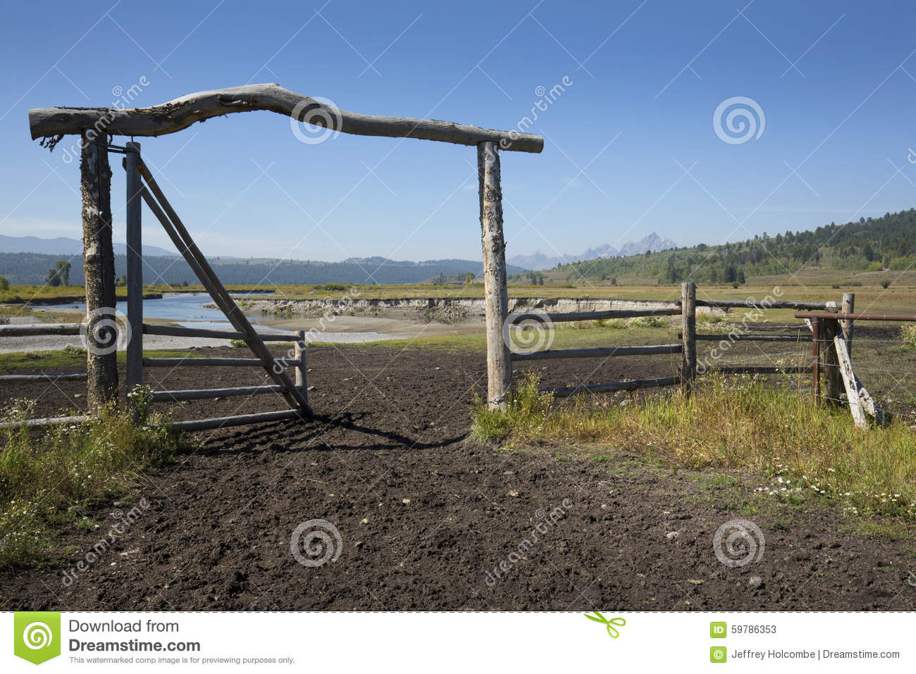 Ranch entry gate in pasture bank of buffalo fork river