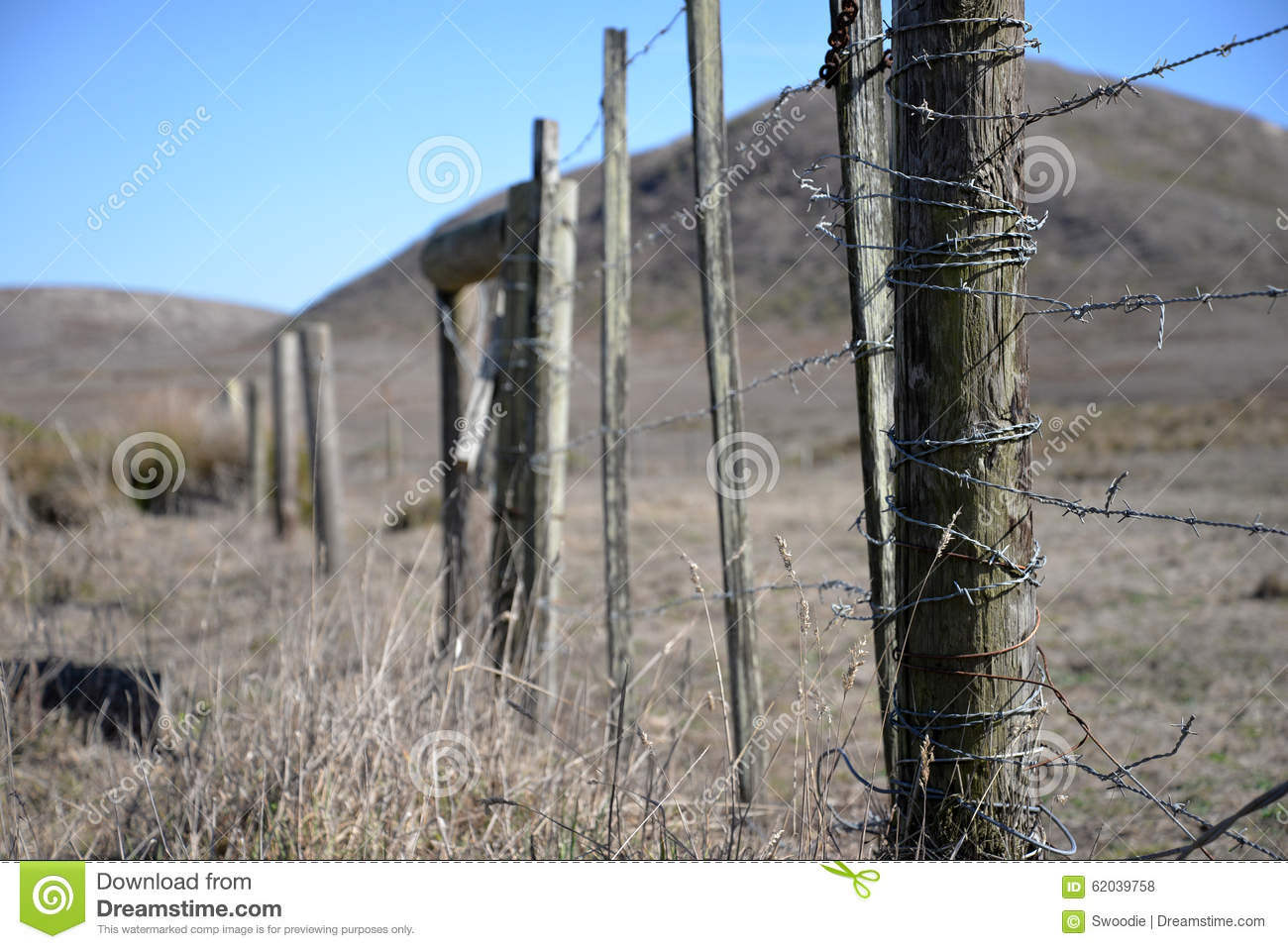 Ranch Fence Post With Barbed Wire Stock Photo - Image of wire ...