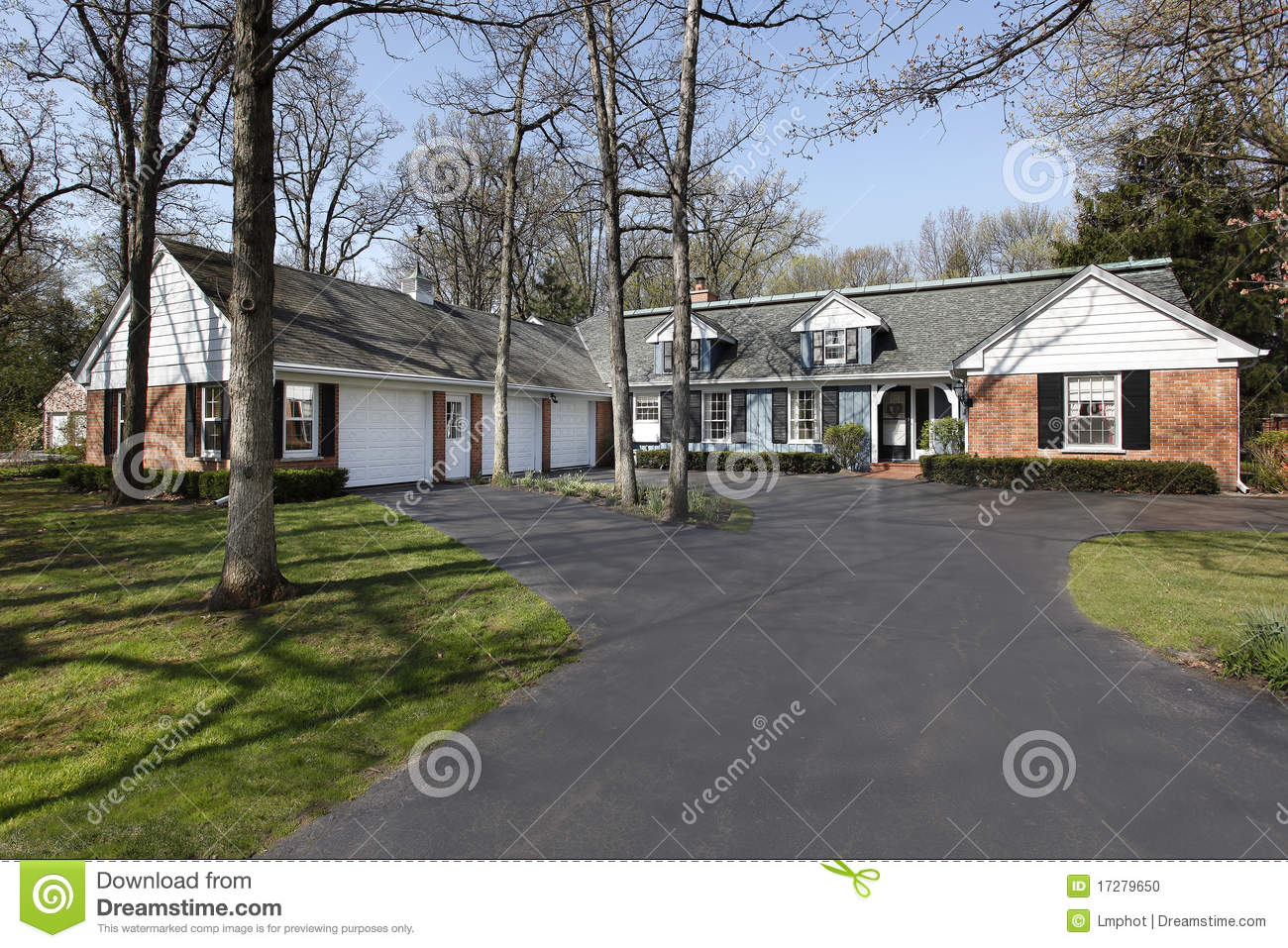 Ranch home with three car garage royalty free stock image for Ranch house with garage