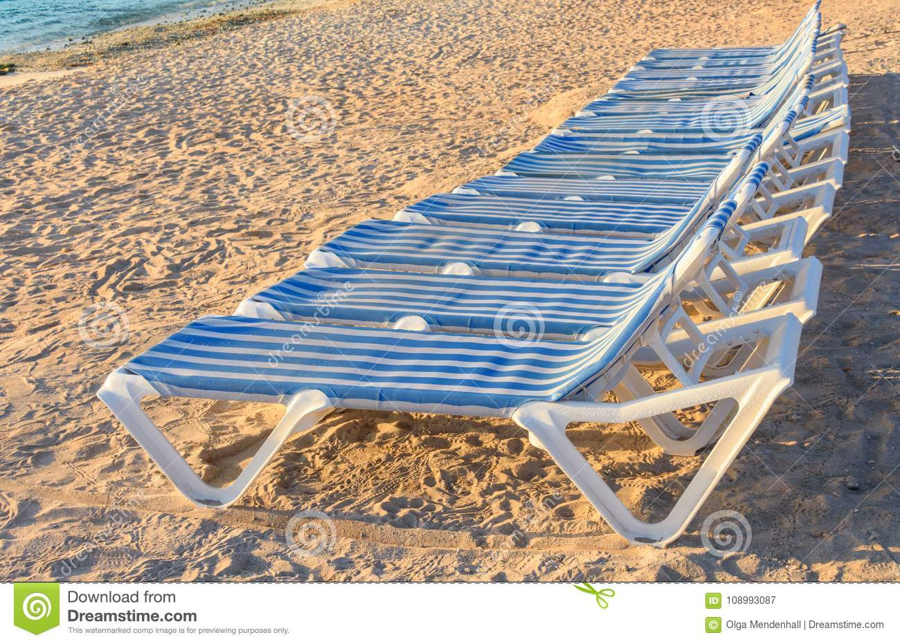 Stupendous Range Of Blue And White Striped Lounge Chairs On A Sandy Caraccident5 Cool Chair Designs And Ideas Caraccident5Info
