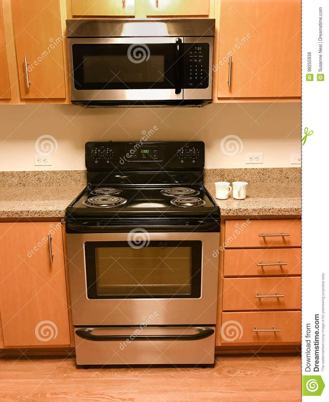 Range, Stove, And Microwave And Kitchen Cabinets Stock Photo ...