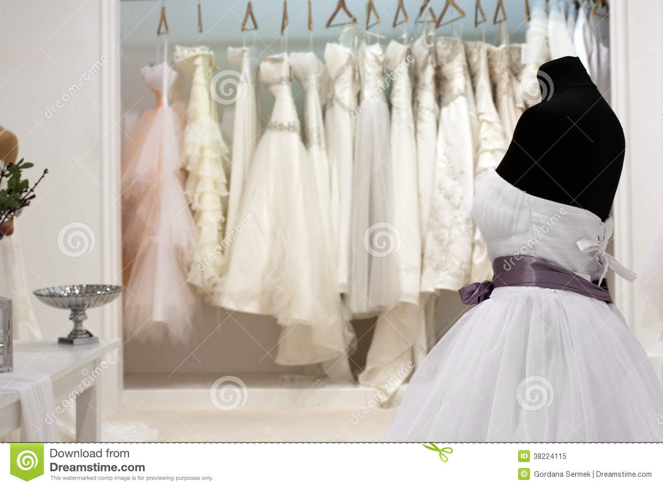 fd58e3798 The range of wedding dresses on hangers and on a mannequin in the showroom