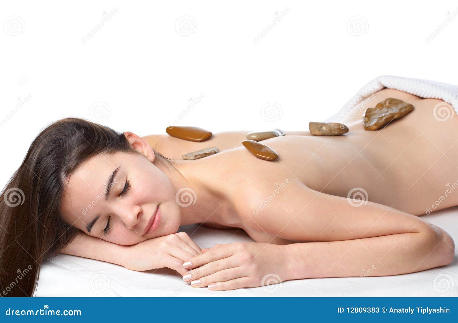 Rapariga da beleza que começ uma massagem