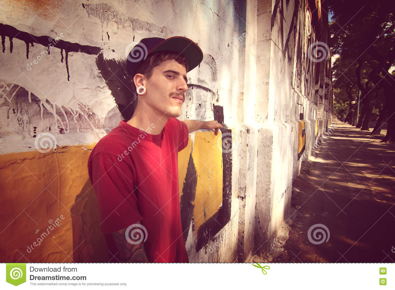 Rapper leaning on a Wall