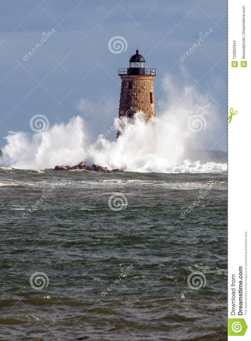 Rare High Tide Causes Giant Waves to Break Around Stone Lighthouse