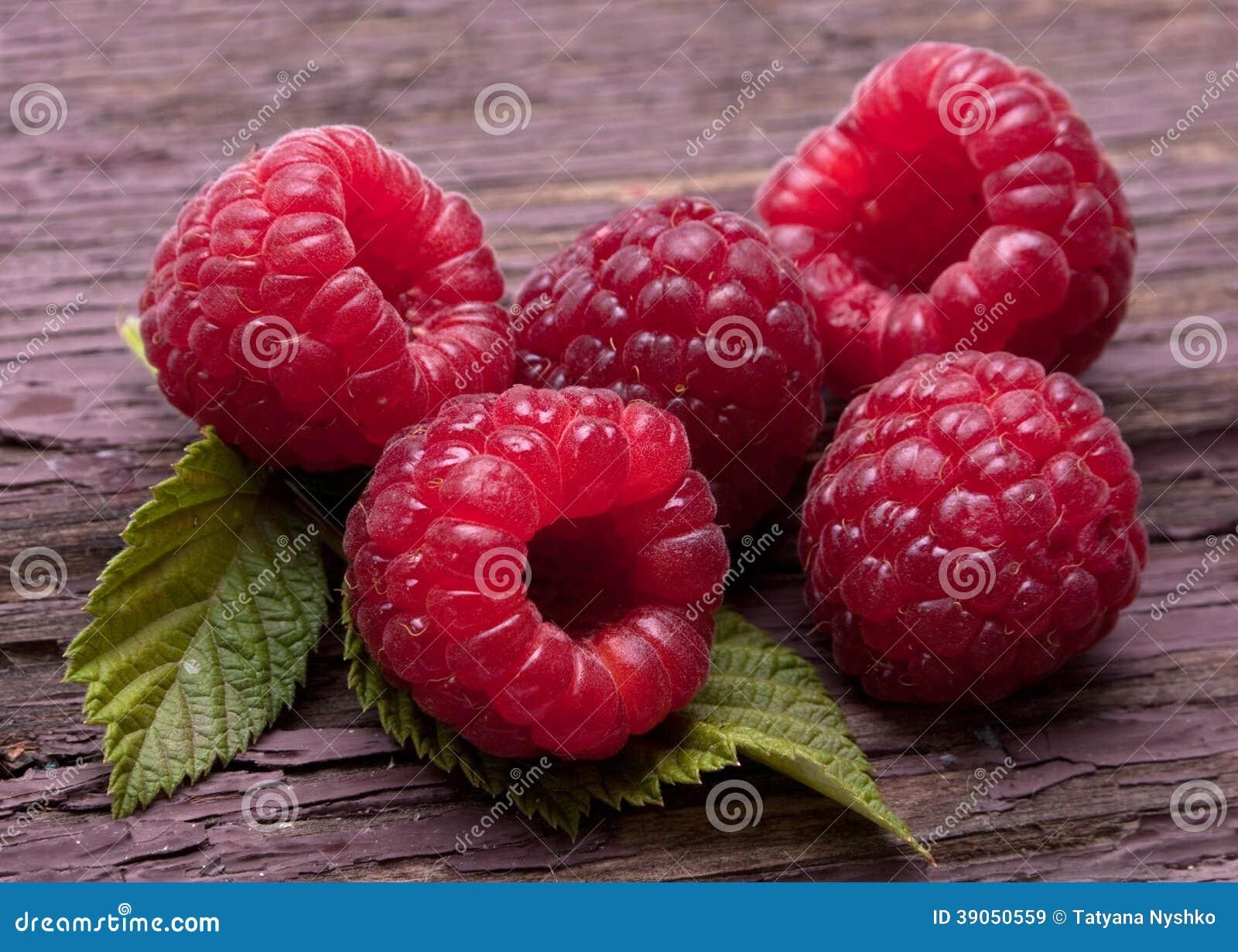 Raspberry fruit on wood