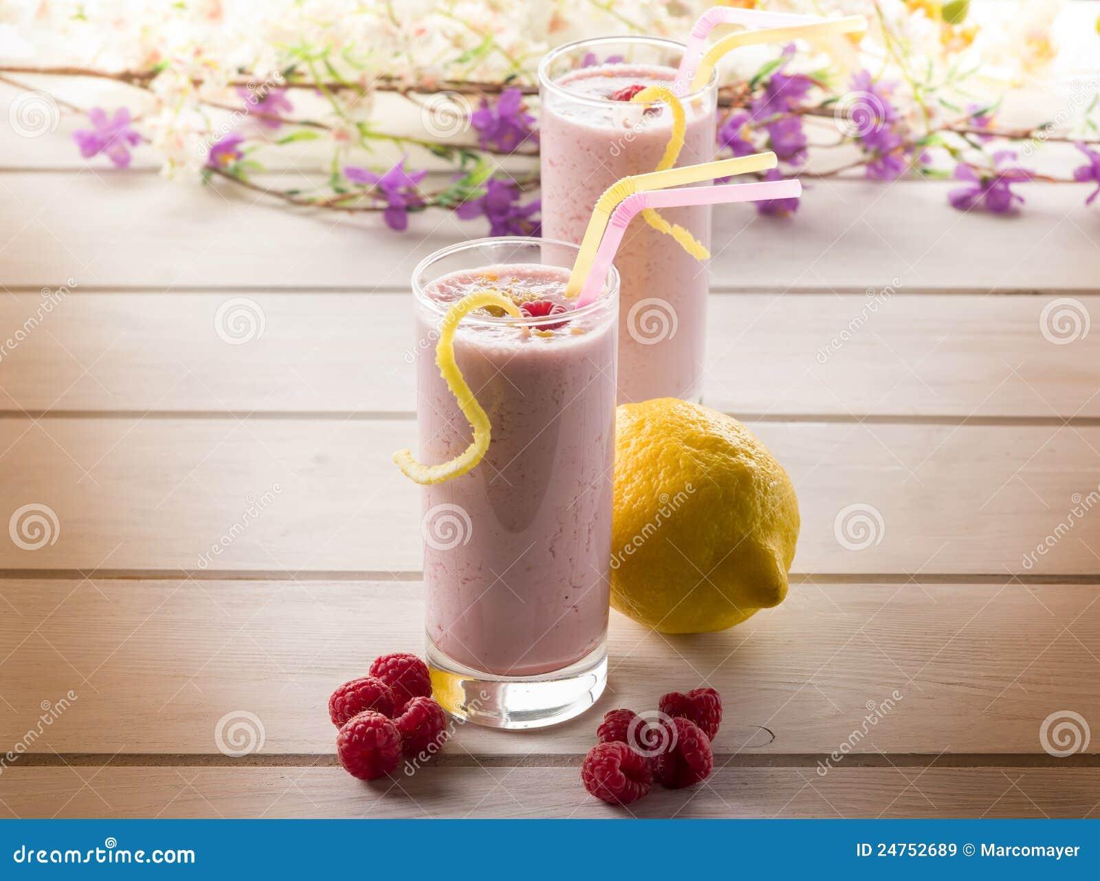 Raspberry milkshake on glass