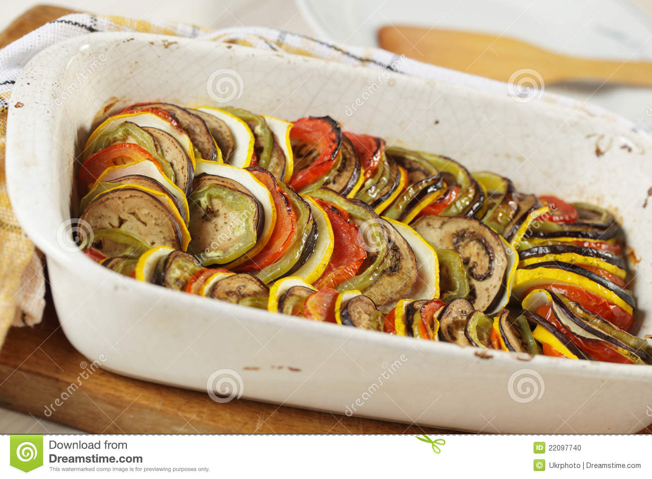 Ratatouille in white casserole on a rustic table.