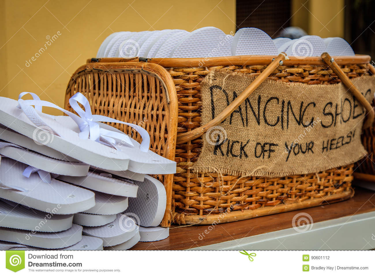 b0754e336 Rattan Basket With White Flip-flops Of Different Sizes For Guests ...