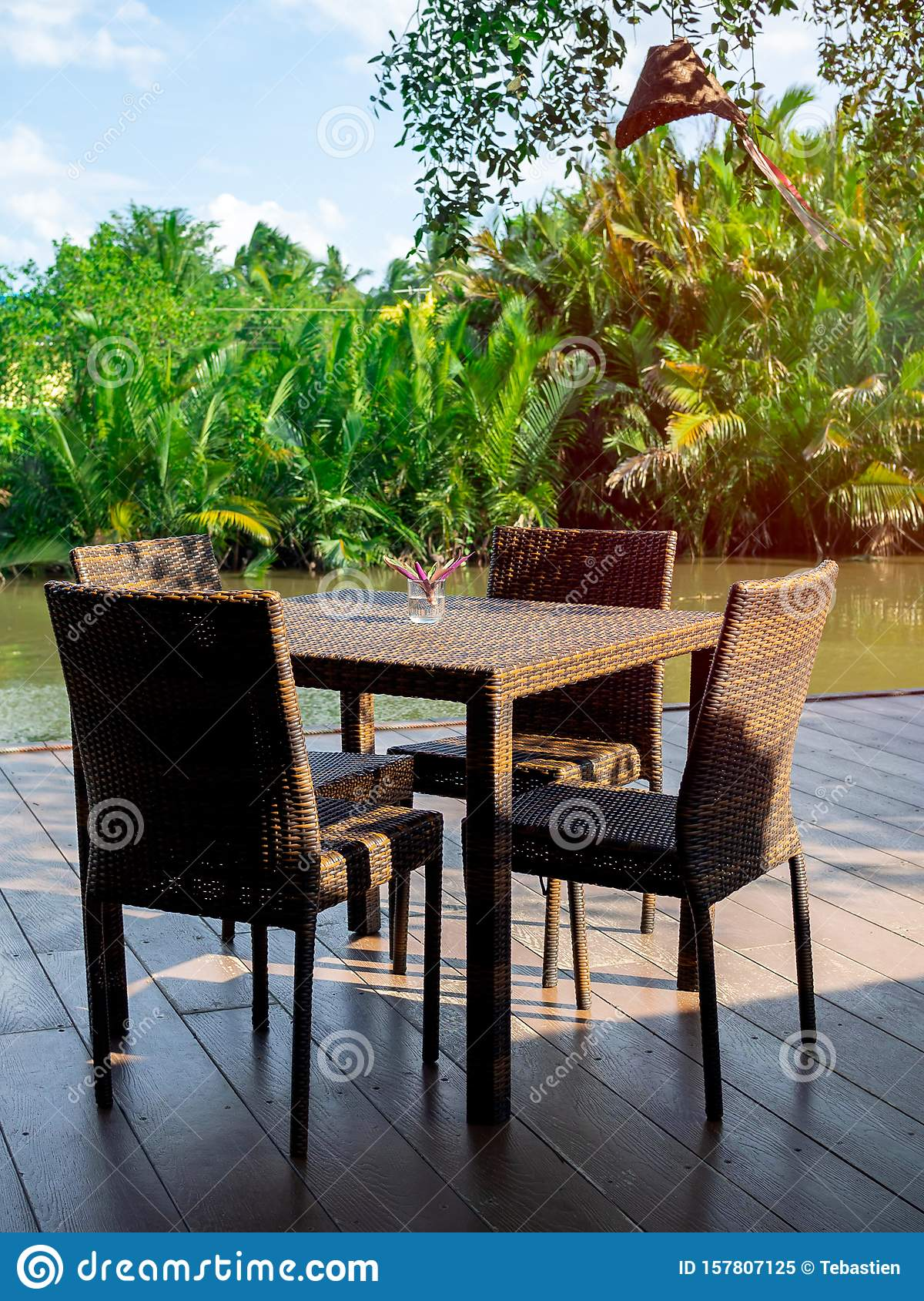 Rattan Dining Table Furniture Set On Wooden Terrace Near ...