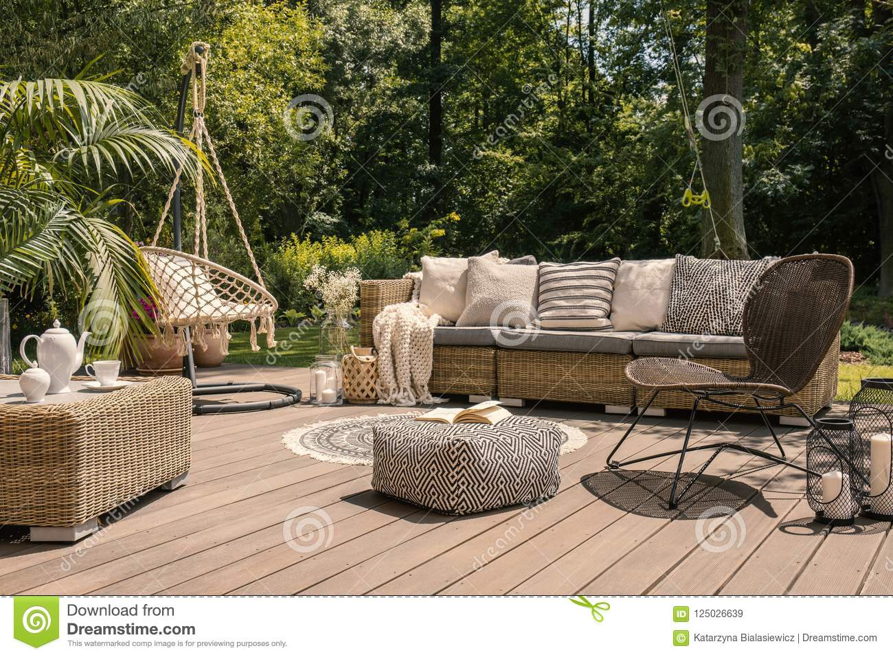 A Rattan Patio Set Including A Sofa A Table And A Chair On A Wooden Deck In The Sunny Garden Stock Image Image Of Patio Cushion 125026639