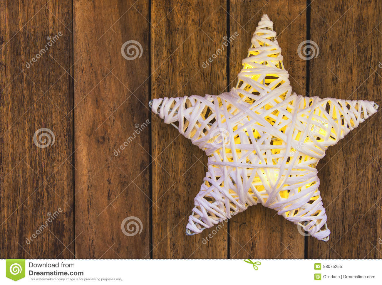 rattans shining white christmas star on weathered plank wood