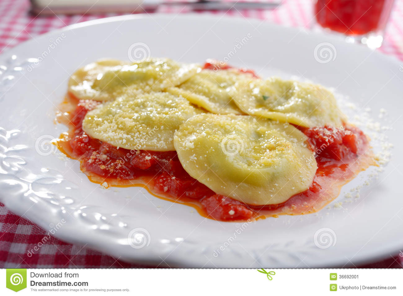 Spinach and ricotta ravioli with tomato and grated Parmesan.