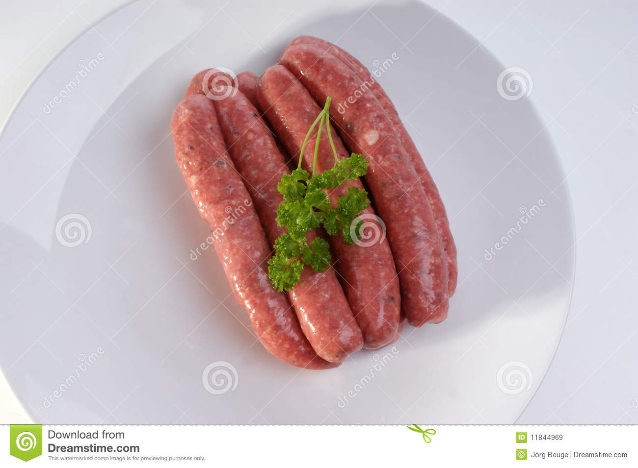 Raw beef sausages on a timber board