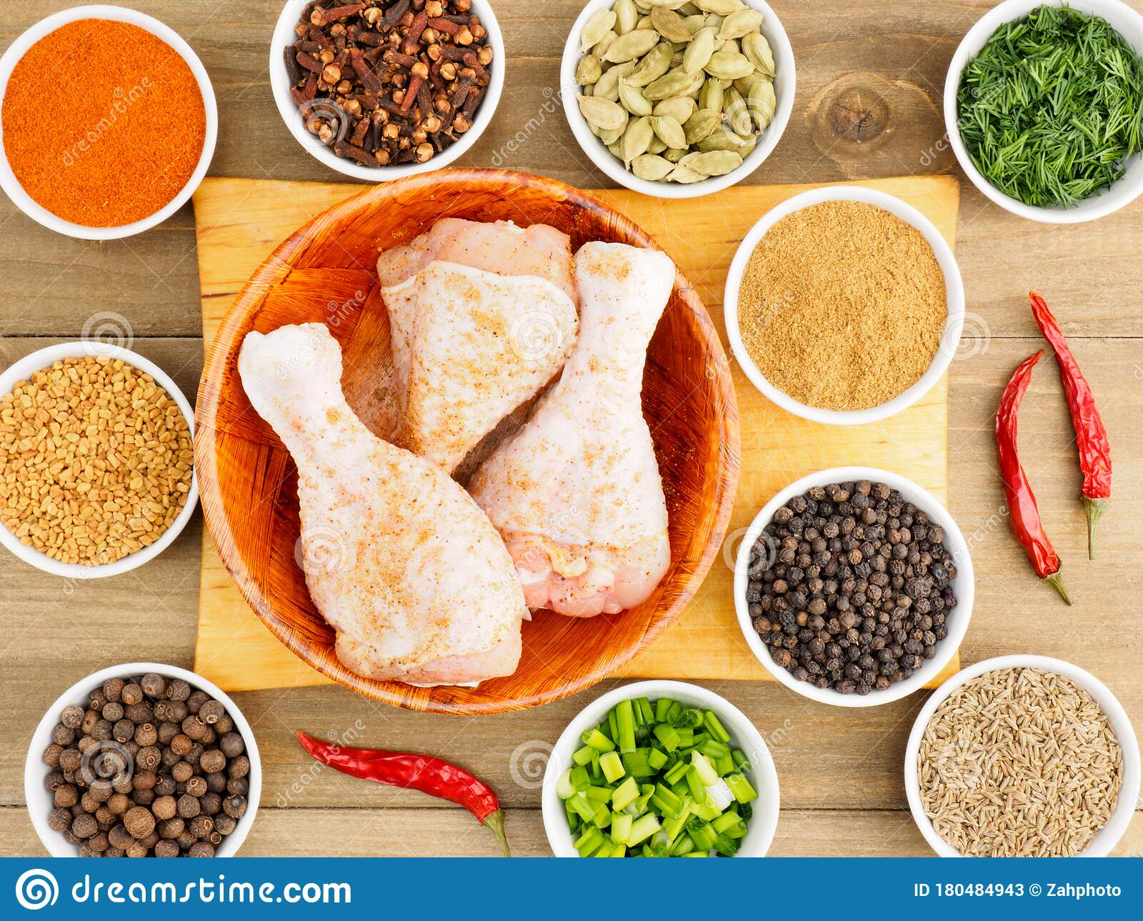 Raw Chicken Drumsticks In A Bamboo Bowl And Spice Set Red Chili Pepper Masala Black Pepper Cumin Fenugreek Cloves Green Stock Image Image Of Bowl Gourmet 180484943